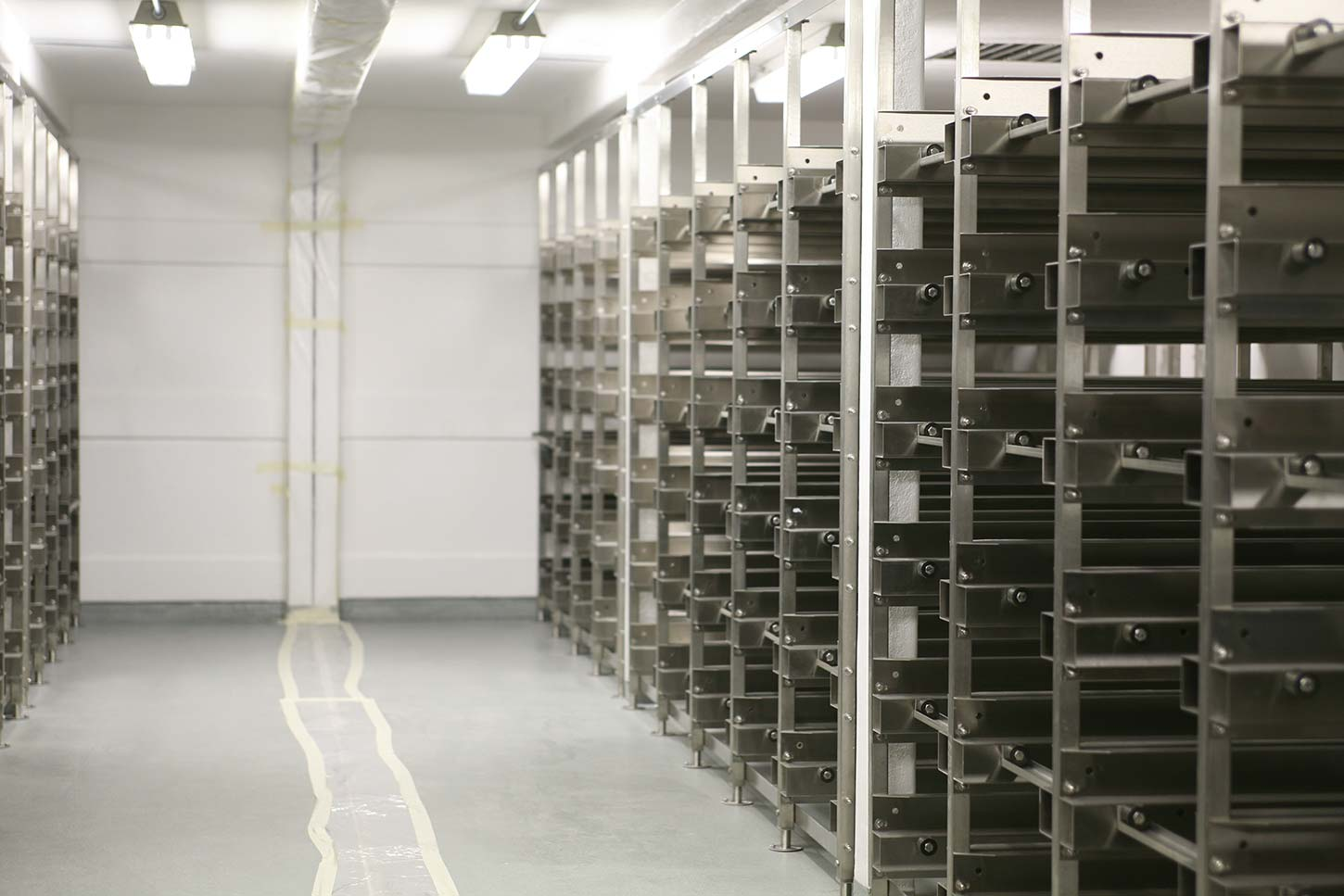 Metal shelving inside cold storage unit