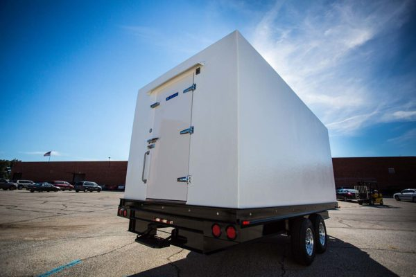 White walk-in freezer cooler trailer outside on concrete