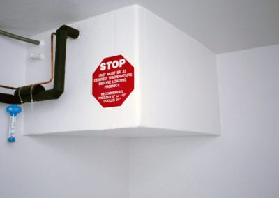 Inside of a polar leasing cooler rental with large stop sign