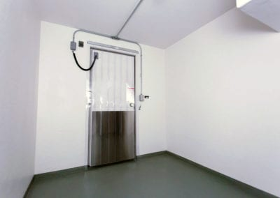 The white door and front walls of a cooler rental unit