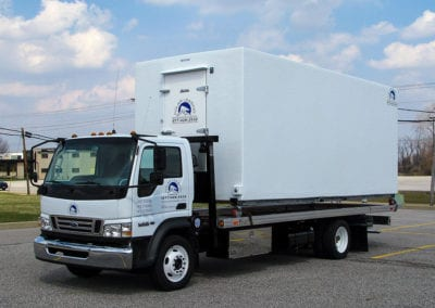 Mobile freezer trailer rental on a truck being transported