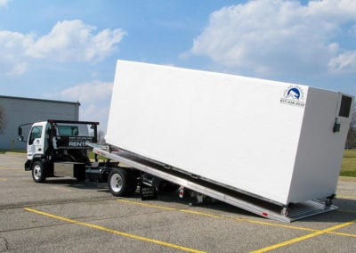 Polar Leasing reefer trailer rental being lifted onto a semi truck