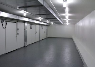 Portable warehousing with white walls and grey flooring